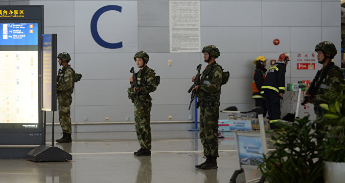 Paramilitary police officers stand guard inside Pudong airport in Shanghai (File)