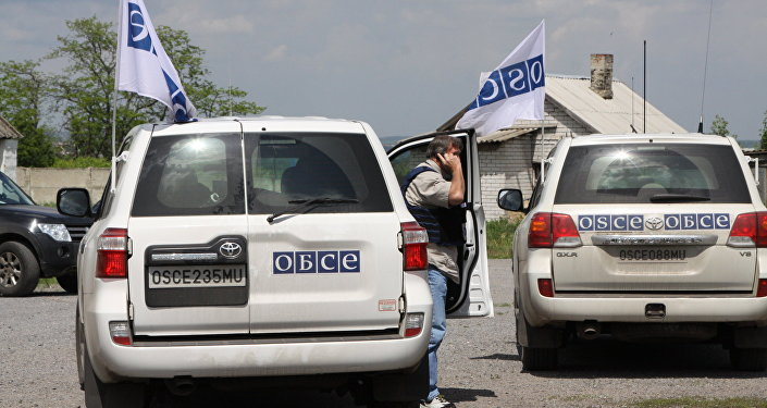 Vehicles of the OSCE Special Monitoring Mission in Dokuchayevsk, Donetsk Region