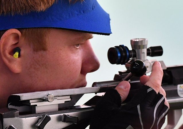 Kirill Grigoryan (Russia) during the men's 50m rifle prone event at the XXXI Summer Olympics