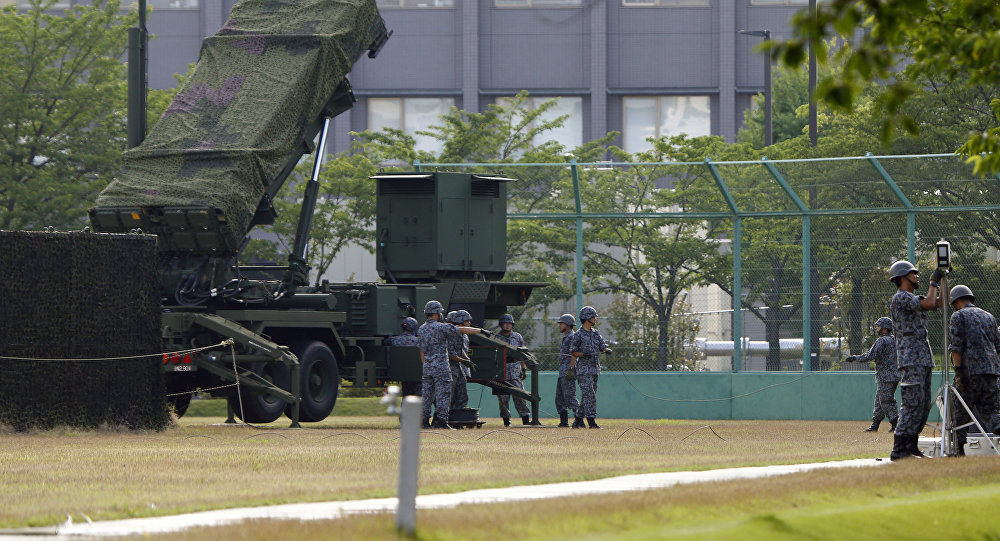 Japan Self-Defense Force members set up a PAC-3 Patriot missile unit in case of a North Korean rocket launch at the Defense Ministry in Tokyo, Tuesday, June 21, 2016