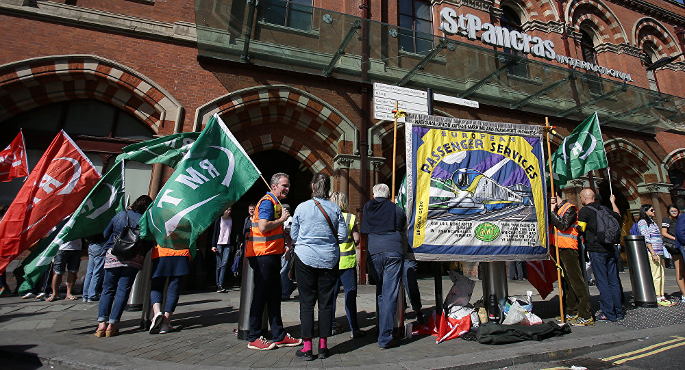 Pickets from the Rail, Maritime and Transport Workers' Union (RMT) demonstrate outside Eurostar's St Pancras International terminal in central London on August 12, 2016