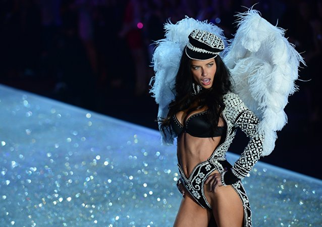 Model Adriana Lima performs during the 2013 Victoria's Secret Fashion Show at the Lexington Avenue Armory on November 13, 2013 in New York