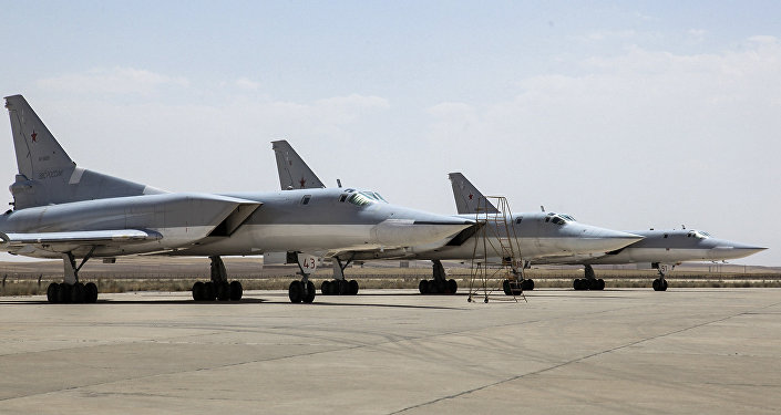 In this photo taken on Monday, Aug. 15, 2016, A Russian Tu-22M3 bomber stands on the tarmac at an air base near Hamedan, Iran.