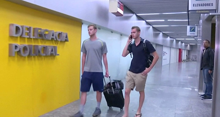 U.S. Olympic swimmers Gunnar Bentz and Jack Conger walk to the airport police station office at Rio's international airport in this still frame taken from video dated August 17, 2016, in Rio De Janeiro, Brazil.