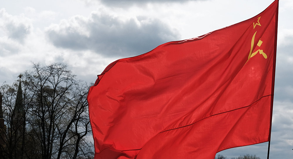 A man with a flag of the Union of Soviet Socialist Republics on Manezhnaya Square in Moscow.