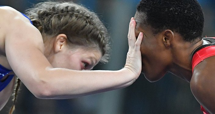 Female wrestler Ekaterina Bukina won bronze in women's freestyle 75 kg defeating Annabel Laure Ali from Cameroon.