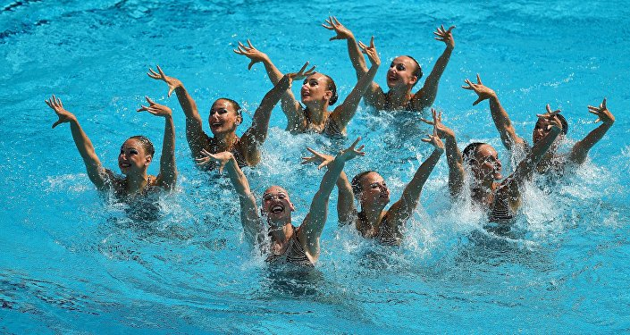 The Russian team performs the technical routine at the synchronized swimming group event at the XXXI Summer Olympics