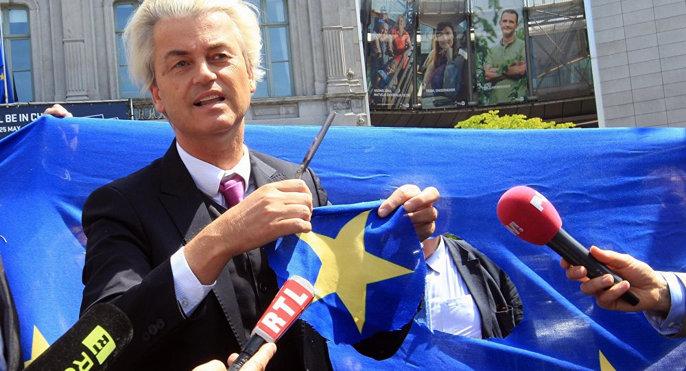Dutch populist and euro-sceptic Geert Wilders displays a yellow star he cut out of the EU flag, during news conference, in front of the European Parliament in Brussels (File)