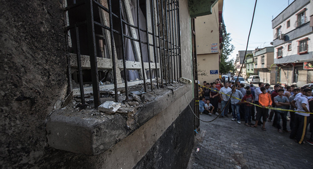 People stand near the explosion scene following a late night attack on a wedding party that left at least 30 dead in Gaziantep in southeastern Turkey near the Syrian border on August 21, 2016