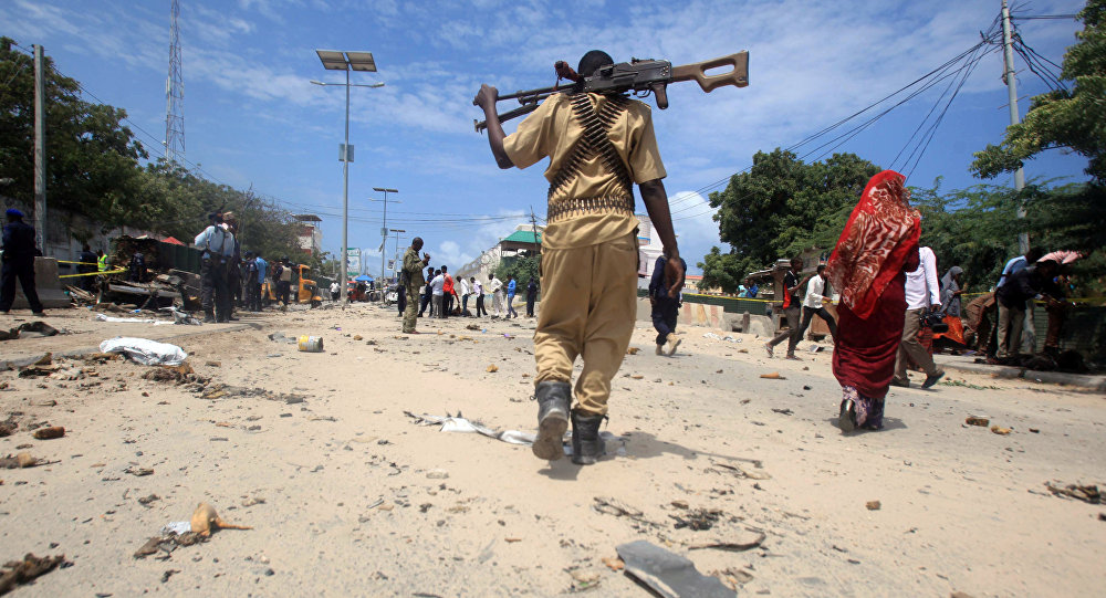 A Somali policeman walks towards the scene of an explosion (File)