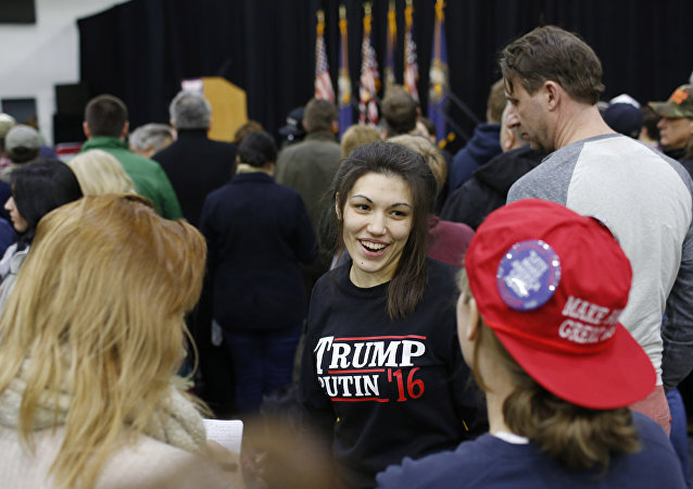 A woman wears a shirt reading Trump-Putin '16 before a rally for Republican presidential candidate Donald Trump at Plymouth State University, February 7, 2016, in Plymouth, New Hampshire