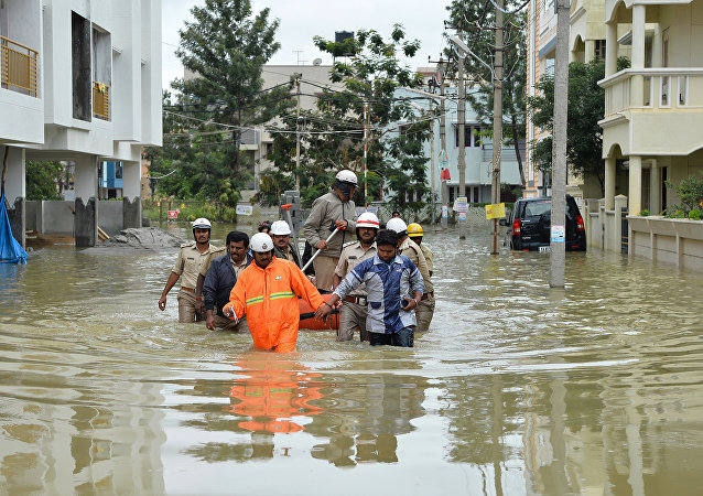 Members of the fire forces and volunteers participate in relief operations in a low lying flooded area of Bangalore (File)