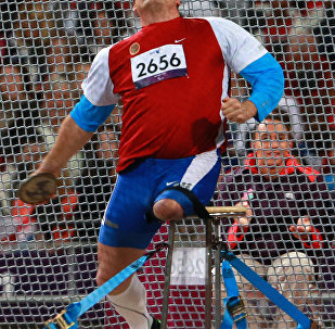 Russian wheelchair athlete Alexei Ashapatov during the discus throw event at the 2012 London Paralympics. He won the gold medal and set a new world record