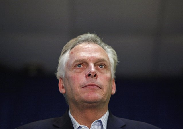 Democratic nominee for Virginia governor Terry McAuliffe stands onstage during a campaign rally in Dale City, Virginia, October 27, 2013
