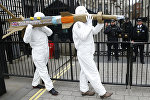 Amnesty International members protest by carrying a mock up of a missile, against the British Government's continued sale of arms to Saudi Arabia outside Downing Street in London, Friday, March,18, 2016