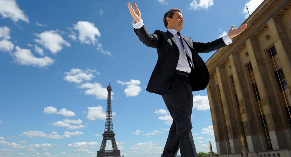 France's President and UMP party candidate for his re-election in the 2012 French presidential elections, Nicolas Sarkozy waves to supporters as he arrives on stage at Trocadero square to deliver a speech during a campaign rally in front the Eiffel Tower in Paris, France May 1, 2012.
