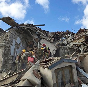 Rescuers work following an earthquake that hit Amatrice, central Italy, August 24, 2016