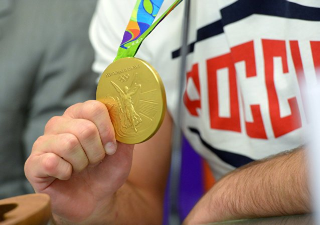 Soslan Ramonov, Rio 2016 Olympic champion in freestyle wrestling, shows his medal at a news conference with representatives of the Russian Wrestling Federation