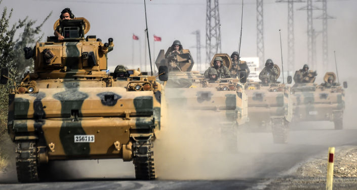 This picture taken around 5 kilometres west from the Turkish Syrian border city of Karkamis in the southern region of Gaziantep, on August 25, 2016 shows Turkish Army tanks driving to the Syrian Turkish border town of Jarabulus.