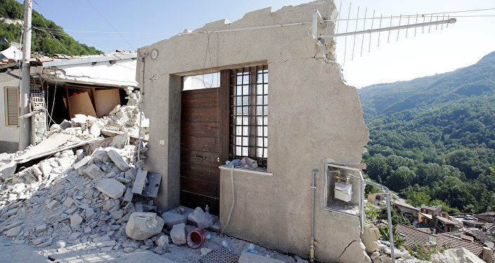 A front door of a collapsed house is seen following an earthquake in Pescara del Tronto, central Italy, August 26, 2016