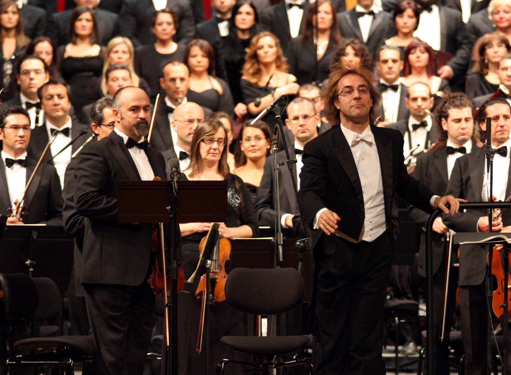 A view of the Bari province symphonic orchestra directed by Fabio Mastrangelo, at right in foreground, during a concert to mark the reopening of the Petruzzelli theatre, in Bari southern Italy. (File)