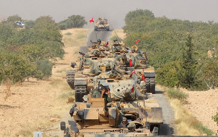 Turkish army tanks make their way towards the Syrian border town of Jarablus, Syria August 24, 2016