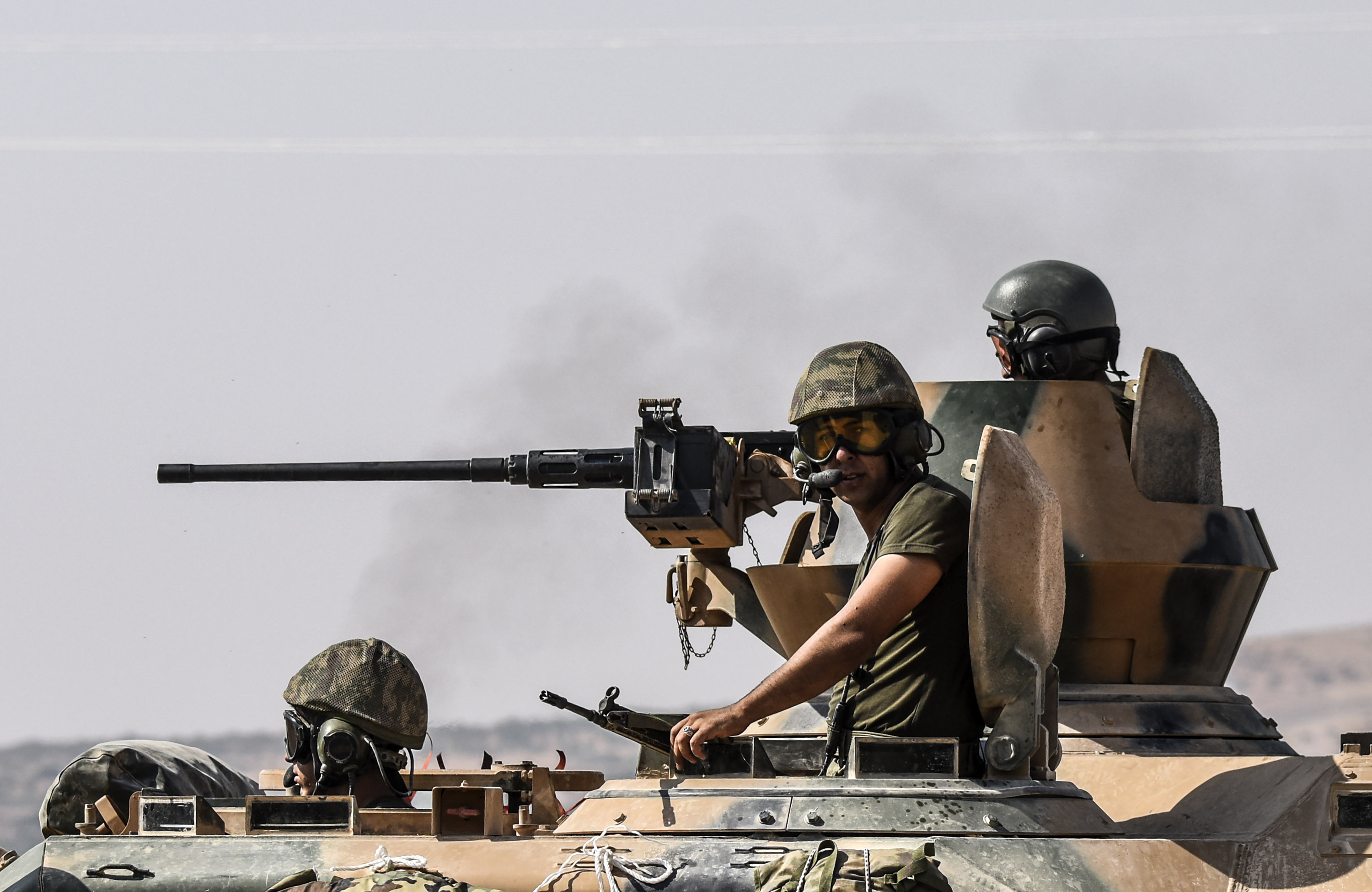 Turkish soldiers sit on a tank driving to Syria from the Turkish Syrian border city of Karkamis in the southern region of Gaziantep, on August 27, 2016