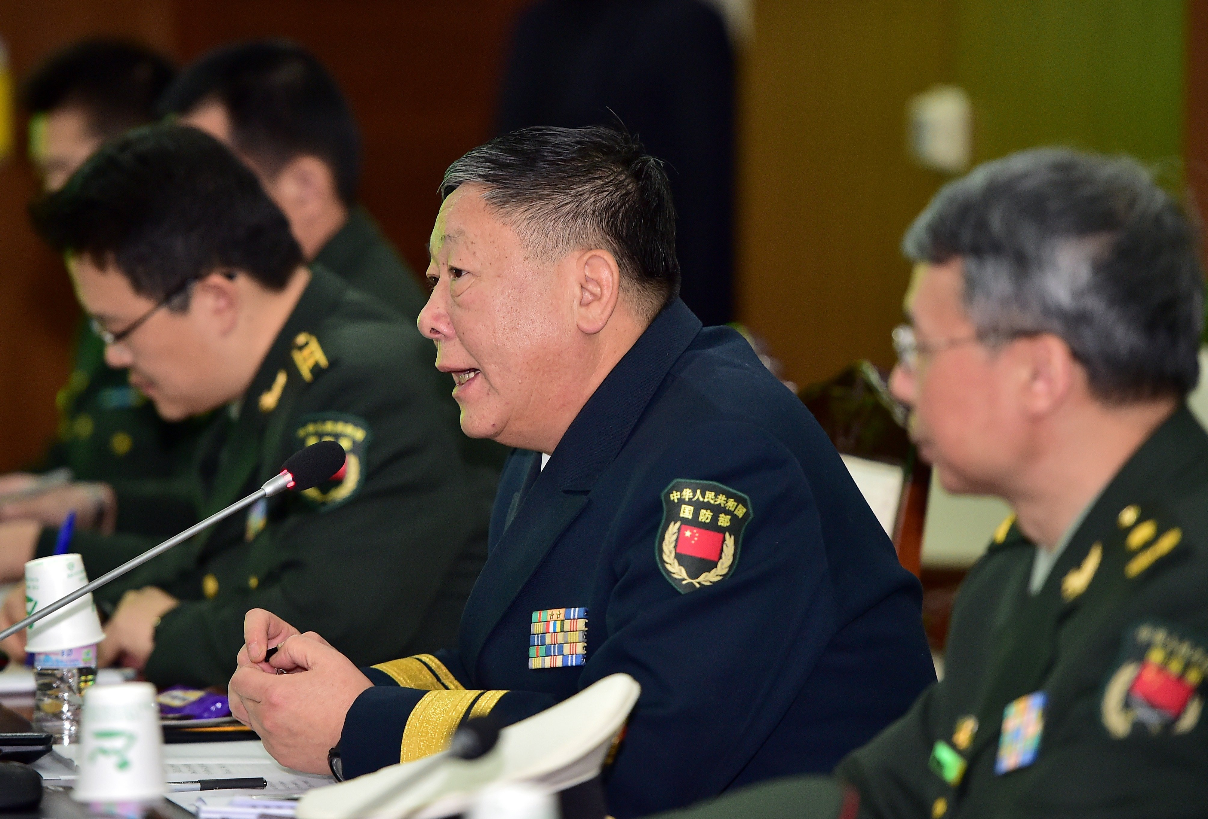 Rear Admiral Guan Youfei (C), director of the newly created Foreign Affairs Office of China's National Defence Ministry, speaks during annual working-level talks with South Korea at the Defence Ministry in Seoul on January 15, 2016. The official visited Syria in mid-August, to the chagrin of Western political analysts.