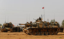 Turkish army tanks and military personal are stationed in Karkamis on the Turkish-Syrian border in the southeastern Gaziantep province, Turkey, August 25, 2016