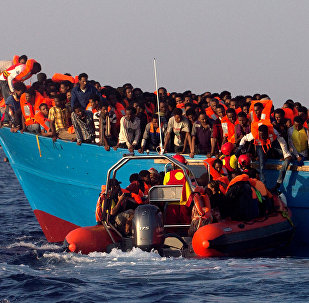 A rescue boat of the Spanish NGO Proactiva approaches an overcrowded wooden vessel with migrants from Eritrea, off the Libyan coast in Mediterranean Sea August 29, 2016