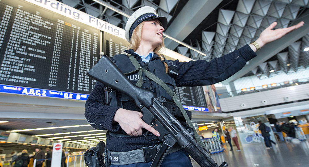 An armed policewoman gestures in Frankfurt Airport, on March 22, 2016, in Frankfurt, western Germany