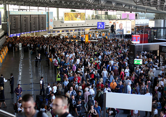 People gather at Frankfurt airport terminal after Terminal 1 departure hall was evacuated in Frankfurt, Germany, August 31, 2016