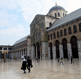Syrian Muslims walk in the courtyard of the historic Umayyad Mosque before weekly prayers in Damascus, Syria. File photo