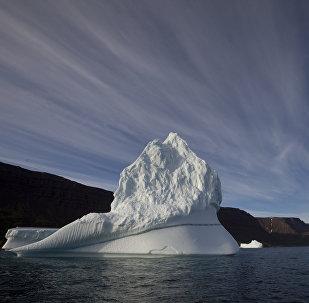 Iceberg floats in the sea near Qeqertarsuaq, Disko Island, Greenland