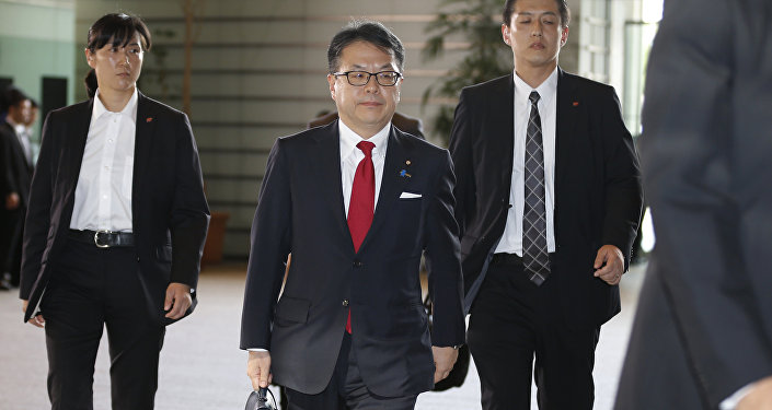 Japan's new Economy, Trade and Industry Minister Hiroshige Seko, center, arrives at the prime minister's official residence in Tokyo