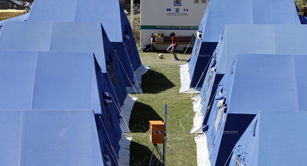 A child plays at a tent camp set as a temporary shelter for the earthquake survivors in Arquata Del Tronto, Italy