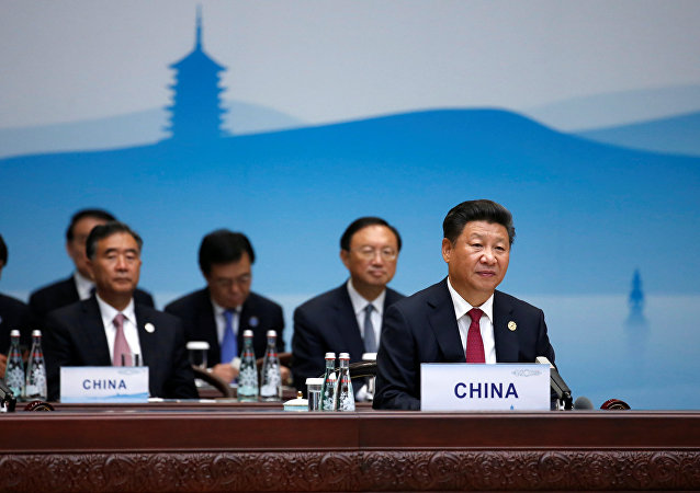 Chinese President Xi Jinping (R) attends the opening of the G20 Summit in Hangzhou, Zhejiang province, China, September 4, 2016.