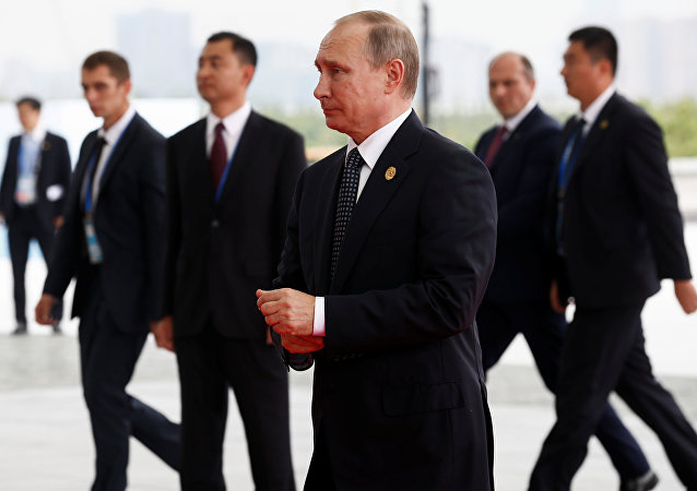 Russian President Vladimir Putin (C) arrives to attend the G20 Summit in Hangzhou, Zhejiang province, China, September 4, 2016.