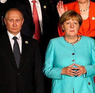 Russian President Vladimir Putin and German Chancellor Angela Merkel attend the G20 Summit in Hangzhou, Zhejiang province, China