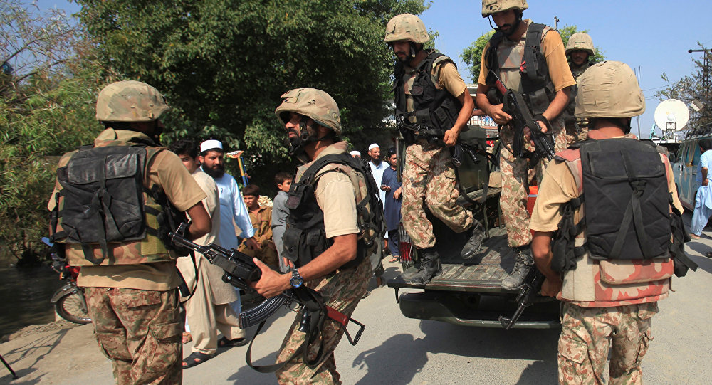 Soldiers arrive at a street after suicide bombers attacked a Christian neighbourhood in Khyber Agency near Peshawar, Pakistan, September 2, 2016