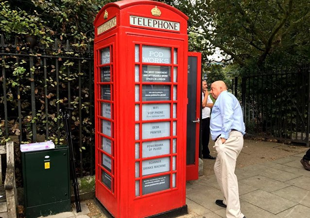 Britain's iconic red public telephone boxes turned into work pods.