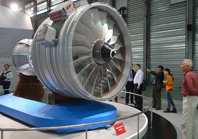This file photo taken on November 7, 2013 shows visitors looking at a full-size model of an aircraft jet engine made by China Aviation Industry Corporation at the China International Industry Fair in Shanghai