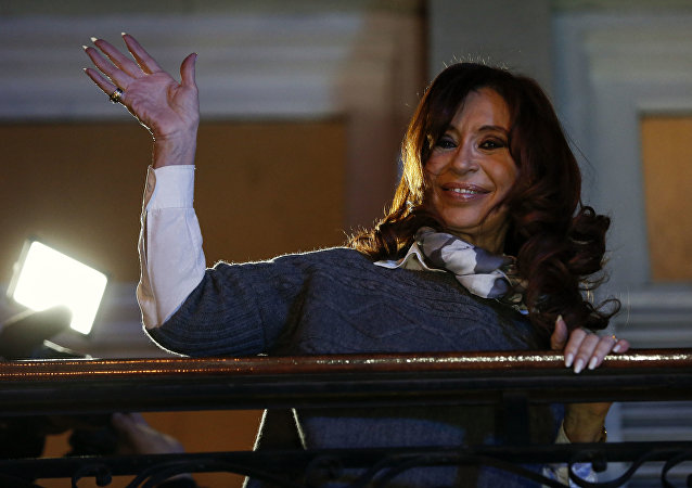Argentina's former President Cristina Fernandez de Kirchner waves to her followers from the balcony of her offices after paying tribute to late Venezuelan president Hugo Chavez in Buenos Aires, Argentina, Thursday, July 28, 2016