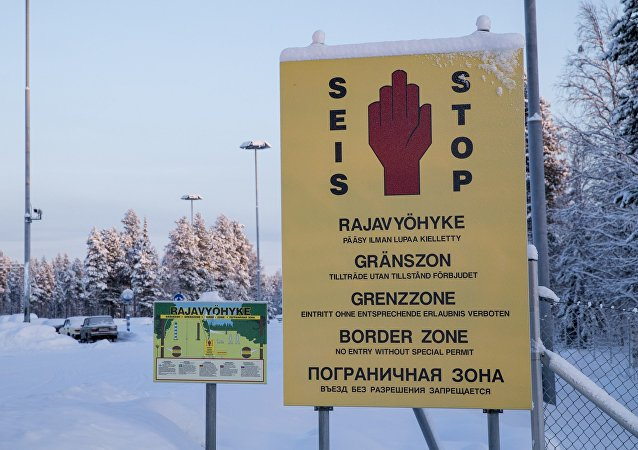In this picture taken January 20, 2016, border zone signs are seen at the Finnish-Russian border in Salla, northern Finland