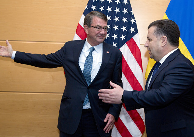 US Secretary of Defence Ash Carter (L) welcomes Ukraine's Defence Minister Stepan Poltorak (R) prior to a meeting at NATO headquarters in Brussels on June 15, 2016
