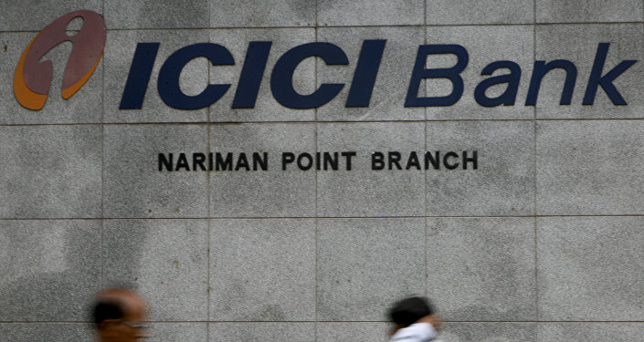 Pedestrians walking outside the ICICI bank in Mumbai, India. (File)