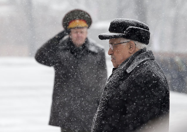 Palestinian President Mahmoud Abbas attends a wreath laying ceremony at the Tomb of Unknown Soldier in Moscow, Russia, Thursday, March 14, 2013.