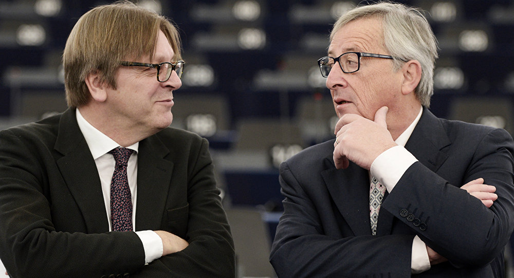EU Commission chief Jean-Claude Juncker (R) speaks with Alliance of liberals and Democrats for Europe (ALDE) group leader and Belgian member of the European Parliament Guy Verhofstadt prior to a debate on the outgoing Italian Presidency of the Council of the European Union, at the European Parliament on January 13, 2015 in Strasbourg, eastern France.
