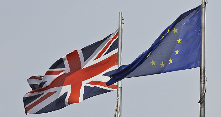 A Union Jack flag and a European flag blow in the wind in front of the city hall in London. (File)