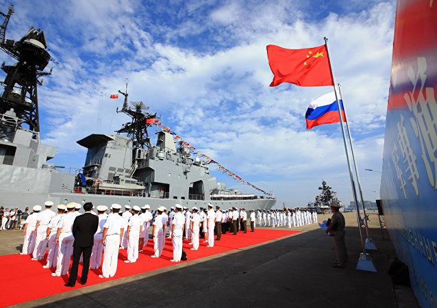 Officers and soldiers of China's People's Liberation Army (PLA) Navy hold a welcome ceremony as a Russian naval ship arrives in port in Zhanjiang in southern China's Guangdong Province